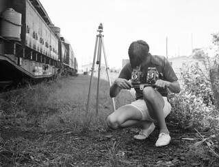 Fred Clark Jr., Florida's well known railroad photographer is working with his bar mounted dual twin lens reflex camera set-up at Sanford, Florida, 1976