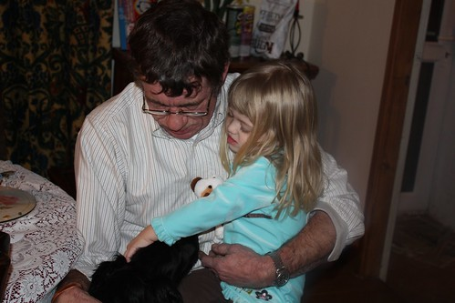 Grandpa Roger & Catie petting Zack the puppy