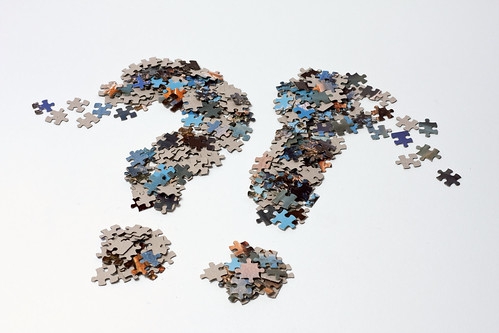 A question and exclamation mark of jigsaw puzzle pieces