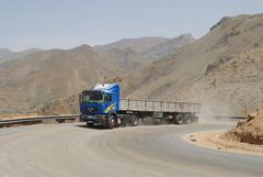 TRUCKING IN MOROCCO (Claude  BARUTEL) Tags: africa man mountains sahara truck desert morocco atlas roads dust curve trucking