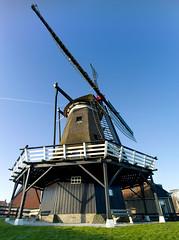 Windmill in Sloten (NL) (HenkVries) Tags: netherlands windmill contrail friesland molen henk windmolen sloten vrieselaar