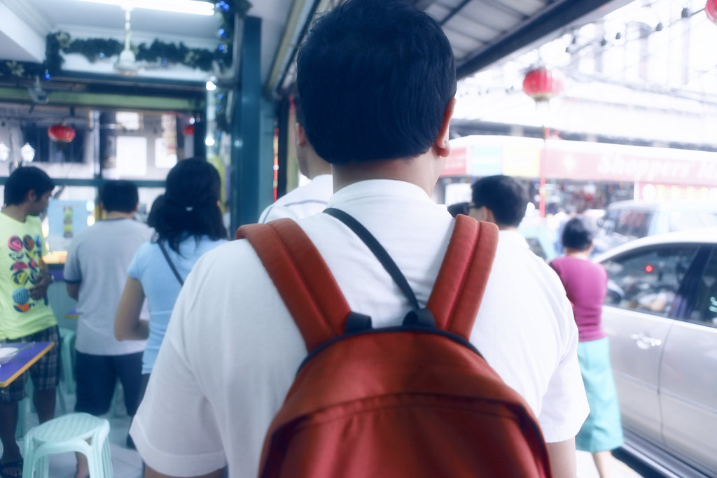 back of the little red back pack man