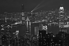 The view from Victoria Peak, Hong Kong; in mono (Mo Baig) Tags: china travel blackandwhite bw skyline architecture night hongkong nikon asia cityscape kowloon allrightsreserved victoriapeak victoriaharbour 200905 nikond40x sigma18200mmoshsm nikonflickraward mygearandme mobaig