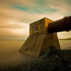 golden fallout (s k o o v) Tags: longexposure beach clouds outlet smelly guernsey stinky bsquare perelle sigma1020 nd110 skoov