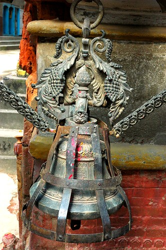 Ornate cast metal offering bell, custom cover and chain, downtown Kathmandu, Nepal by Wonderlane