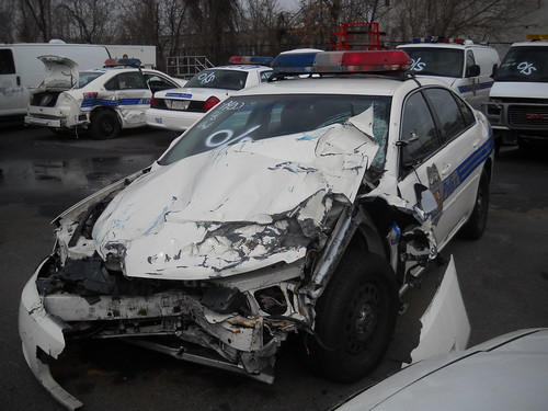 smashed up cop car in baltimore city. this is the lot they keep the smashed