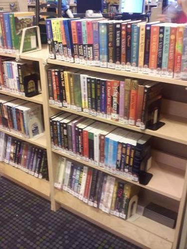 slanted bottom shelves for easier browsing in large print