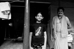 Daddy's Pride (knowsnotmuch) Tags: bw girl proud tv father tokina1224 swing traditionalhouse mylapore 26thchennaiphotowalk iknowthecompoisnotperfectbut