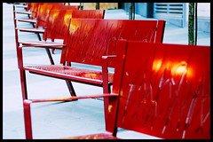 Benches at Fairmont Pacific Rim (Eric Flexyourhead (YVR catch-up mode!)) Tags: street city red urban canada vancouver bench hotel downtown bc britishcolumbia sidewalk repetition benches zd 50mmmacro20 50mmmacrof20 fairmontpacificrim olympuse3