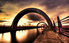 Falkirk Wheel at Sunset - good news and bad news (Semi-detached) Tags: sunset cloud motion water wheel modern clouds scotland canal long exposure glow union scottish structure hdr falkirk
