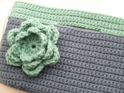 Crocheted clutch with flower