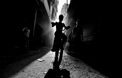 The rider (fahim_123752) Tags: street light people bicycle kid streetphotography lad rider olddhaka bangladeshistreetphotography