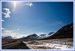 Bright day in april (joningic) Tags: road blue light sky sun snow mountains clouds iceland northiceland hrgrdalur flickraward