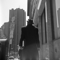 dapper (patrickjoust) Tags: street city urban bw usa white man black 120 6x6 tlr blancoynegro film home hat smart analog america square lens us reflex md focus downtown shanghai mechanical cathedral coat united towers patrick twin maryland charles super baltimore sharp well 150 v epson medium format 100 fedora states manual 500 rodinal joust developed ricoh dressed develop dapper estados 80mm f35 blancetnoir unidos ricohflex v500 gp3 schwarzundweiss autaut rckenfigur  patrickjoust
