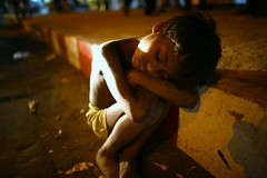 Sweet dreams.... (N A Y E E M) Tags: road street nightphotography night child sleep beggar drain society footpath bangladesh disgust headlamps chittagong canoneos5d 1030pm canonef24mmf14lusm rohingya nayeemkalam royalhut outerstadium