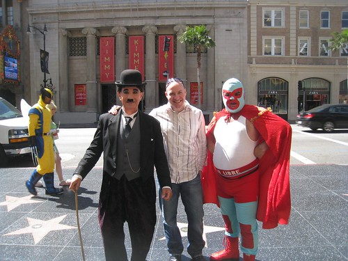Photo-op with Charly Chaplin and Nacho Libre, with Wolverine and Tinkerbell walking past.