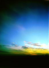 Holga 3 (SleepLab) Tags: blue light sunset shadow sky blur 120 home yellow skyline clouds contrast landscape holga lomo parkinglot exposure day texas shadows earth dream garland noflash scanned dreamy illford rowlett sureal ilford dreamscape settingsun
