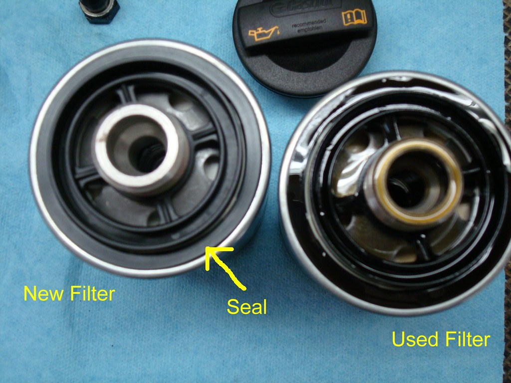 Using your finger or a shop towel apply a light film of fresh engine oil onto oil filter seal