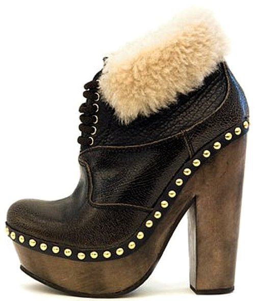 Miu Miu - Leather lace-up clog ankle boot with shearling lining.