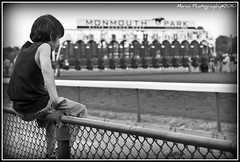 Jersey Boy (EASY GOER) Tags: boy horses blackandwhite bw horse sports animals racetrack digital canon fence 50mm photo newjersey kid athletics focus gate dof child shot action candid politics competition running racing entertainment runners 12 athletes races vignette equine competion thoroughbreds 2010 monmouthpark sportofkings nyra startinggate 50d