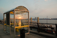 Strange old sunset tonight... (baz_baziah) Tags: sunset liverpool busstop pierhead refelection