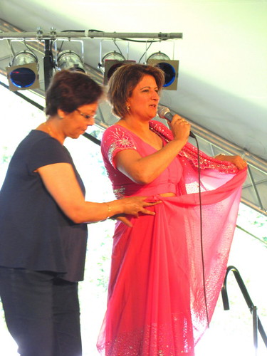Sawan Mela South Asian Summer Festival, how to put on a Indian sari demonstration