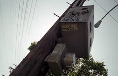 AWARE (QsySue) Tags: slr graffiti losangeles box stickers wideangle powerlines wires melrose hollywood meter telephonepole canonae1program aware slaps colorfilm melroseave melrosealley dollarstorefilm 28mm128 35mmfilmcamera memories35mmfilm