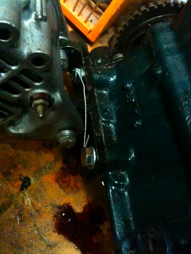 Alternator bracket lockwired as well as thread locked - Course threads are a real pain...