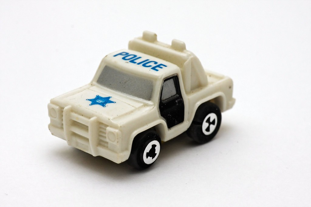 White toy police pick-up truck with black doors