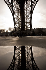 Alone... staring at an empty pond... or at least what I thought was empty (Blue-Eyed-Caz) Tags: sky paris france reflection water tarmac metal clouds puddle pond poem steel eiffeltower tourists structure abstact
