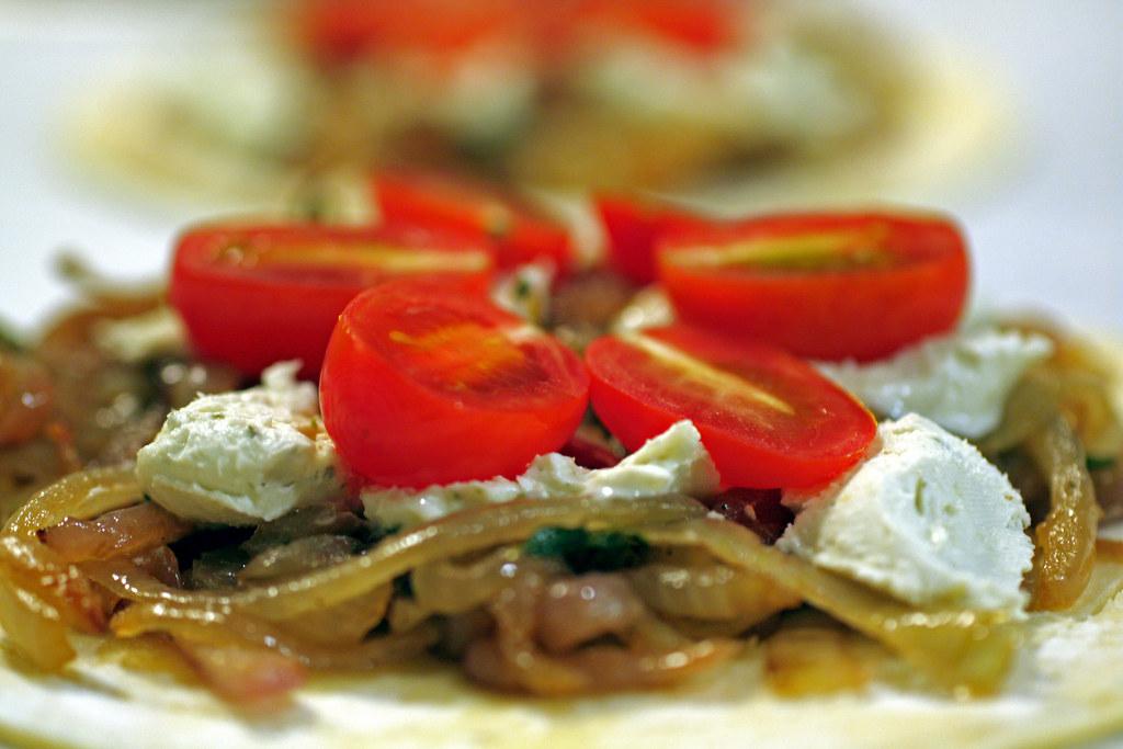 assembling tomato & goat cheese tarts