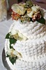 white flowers white wedding cake photo
