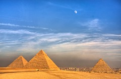 The Moon over the Pyramids (Matt Champlin) Tags: world life old travel blue sky moon sahara nature sphinx clouds canon landscape sand ancient desert egypt middleeast cairo huge pyramids incredible giza threekings gizapyramids greatpyramidsofgiza mywinners abigfave thethreepyramids