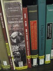 Reference books on a shelf.