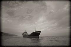 Honey, baby, I'm sorry, I won't be getting home anytime soon (Mojca Androjna) Tags: beach ship monochromatic photoaday 365 stranded sandybay kilyos project365 strandedship