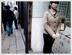 girl working at a gift shop (-{ thus }-) Tags: china street winter people woman color digital wuzhen ricoh 2009 giftshop  grd3 thusihaveseen grdiii