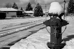 Unneeded during winter? (jcforgod) Tags: shadow blackandwhite bw snow lamp hydrant butte firehydrant lamppost