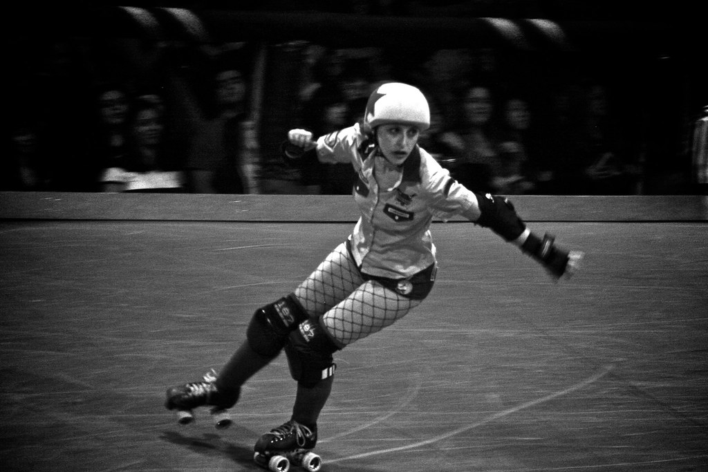 super cool black and white action sports photography of roller derby skater by indie photographer Jessica Schilling