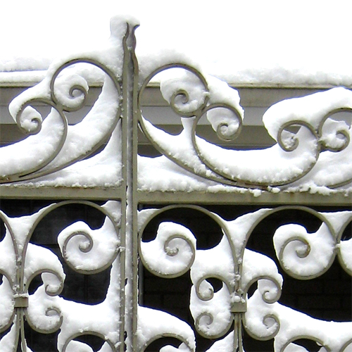 Snow on filigree gate
