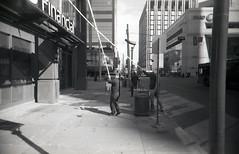 window washing (teh hack) Tags: street camera bridge bw film mike analog trash toy downtown edmonton slim wide delta nb iso plastic alberta 400 200 pro asa clone vivitar ultra ilford ei toycam analogic trashcam 22mm ddx ilfotec eximus