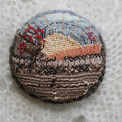 Winter Sunset Brooch (Lynwoodcrafts) Tags: winter sunset wales landscape miniature berries wintersunset embroidery brooch textile ribbon applique textileart ploughed ribbonembroidery silkribbonembroidery silkribbon miniaturelandscape madeinwales purewool embroideredbrooch textilebrooch landscapebrooch