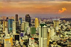 Bangkok Skyline at Sunset (I Prahin | www.southeastasia-images.com) Tags: sunset red sky beautiful skyline bar river thailand golden democracy riot bangkok military politics rally protest police peaceful mob demonstration drinks stunning violence cocktails democrat redshirt sirrocco coup silom cityofangels erawan skybar statetower thedome thaksin udd lebua ratchaprasong highestbar worldsbestbar lebuahotel totallythailand abhisitvejjajiva gettyimagessoutheastasiaq1