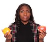 Apples to Oranges - African American businesswoman (dgilder) Tags: people orange woman usa apple fruit female austin person pretty texas whitebackground africanamerican produce studioshot choice adults decision unsure 20s choosing comparision indecision welldressed businesswoman lookingatcamera midadultwomen isolatedonwhite dgf20