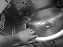 Airplane bathroom (Surat Lozowick) Tags: me water metal plane airplane bathroom flying hand sink air stall 11 drain tiny faucet ba britishairways 52 claustrophobic 2010 week11 52weeks hh52 project52 ba288 hoohaa52 hh5211