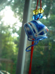 coming undone (bettyy27) Tags: blue red sunlight white green window beads string unraveling