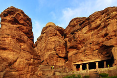 Badami Cave 1 With The Sand Stone Cliffs ! (Anoop Negi) Tags: blue red portrait bali india holiday tourism monument rock religious photography for photo sandstone media vishnu image photos cut delhi indian religion bangalore creative