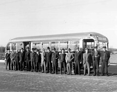 Engineers, business executives, and City of Seattle employees standing in front of bus