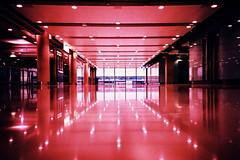 Terminal 5 #1 (m+b) Tags: pink red reflections lights airport crossprocessed heathrow lomolca heathrowairport terminal5 terminalfive fujivelvia100f