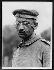 Type of German prisoner captured in the new push (National Library of Scotland) Tags: france portraits soldier war propaganda wwi great photojournalism worldwari worldwarone soldiers uniforms ww1 pow greatwar heer spectacles firstworldwar flanders pows prisonerofwar weltkrieg prisonersofwar germanarmy thegreatwar tunics 19141918 warphotography photographicprints capsheadgear nickelbrille imperialgermanarmy krtzchen nls:dodprojectid=74462370 organization:library=nationallibraryofscotland owner:name=nationallibraryofscotland nls:source=solrxml blackandwhiteprintsphotographs worldwar19141918campaignswesternfront dressculturerelatedconcept nlsshelfmark nlsvoyagerid nls:dodid=74545944 nls:derivative=94 reichsheer kaiserlichdeutschesheer