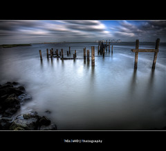 Here was a Pier (Feo David) Tags: blue sky usa cloud lake cold water clouds america canon pose eos pier louisiana rocks eau long exposure texas unitedstates pass calm ciel filter nd damage 5d nuage nuages calme rochers hoya sabin etatsunis longue nd400 fushing detruit destroyerd